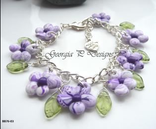 Polymer clay purple & white flower charm bracelet